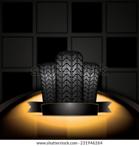 Black rubber tire on golden background - stock photo