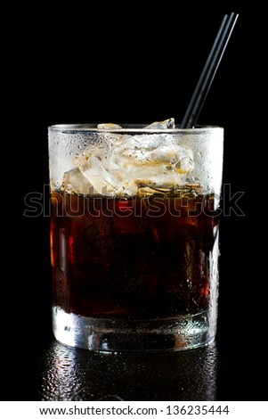 black russian cocktail isolated on a dark background served on the rocks