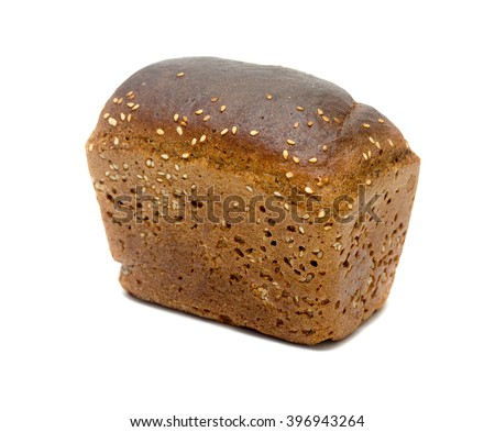 Black rye bread with sesame seeds on a white background - stock photo