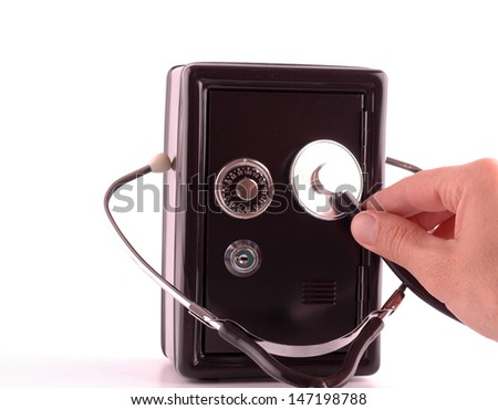Black safe case with hand and stethoscope isolated on white background, money saving risk concept - stock photo