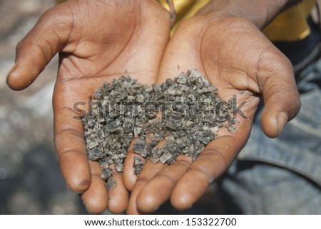 Black salt from the crater lake El Sod, Ethiopia. - stock photo