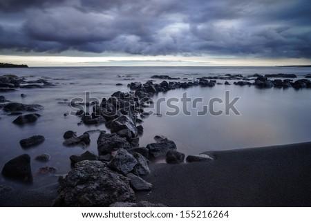Black sand beach at sunset, Big Island, Hawaii - stock photo