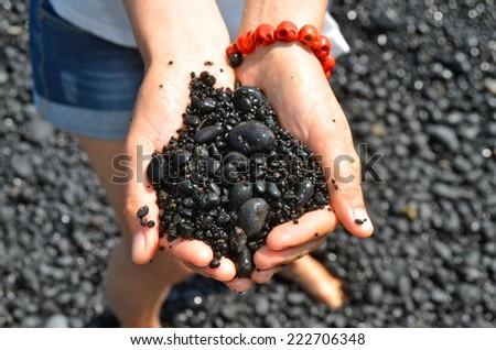 Black sand beach in Hawaii, Maui, USA - stock photo