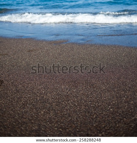 Black sand beach volcanic - stock photo