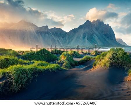 Black sand dunes on the Stokksnes headland on southeastern Icelandic coast. Iceland, Europe. Artistic style post processed photo. - stock photo