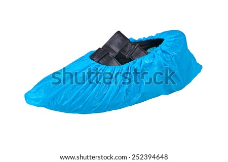 Black sandal in overshoes over white - stock photo