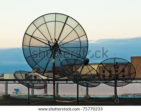 Black Satellite dish on high building