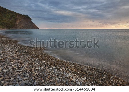 Black Sea and stone coast at evening. The beach of Arhipo-Osipovka, Gelendzhik, Russia