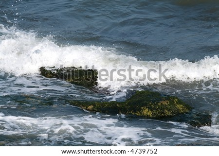 Black sea with cliffs - stock photo