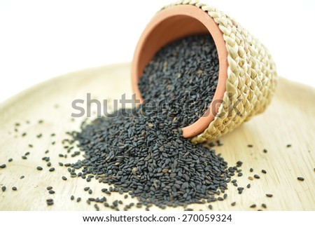 Black Sesame Seeds, It is widely naturalized in tropical regions around the world and is cultivated for its edible seeds, which grow in pods. - stock photo