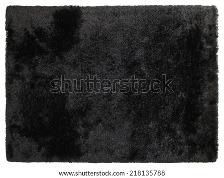 Black shaggy carpet of handwork - stock photo