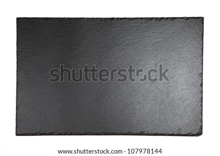 Black shale plate on white background - stock photo