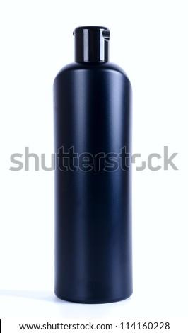 Black shampoo bottle isolated on white - stock photo