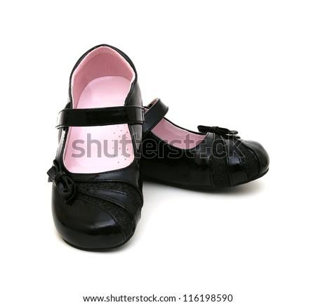 Black shine leather girl shoes isolated on white - stock photo