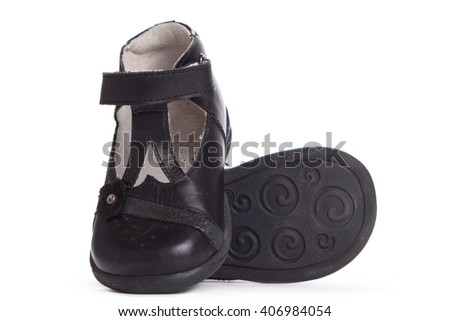 Black shine leather girl shoes isolated on white.