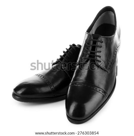 Black shiny man shoes isolated on white - stock photo