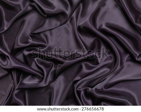 Black shiny silky fabric abstract background texture - stock photo