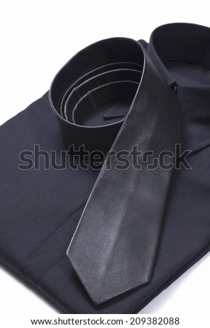 Black Shirt and Black Leather Tie - stock photo