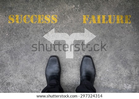 Black shoes has decision to make at the cross road - success or failure - stock photo