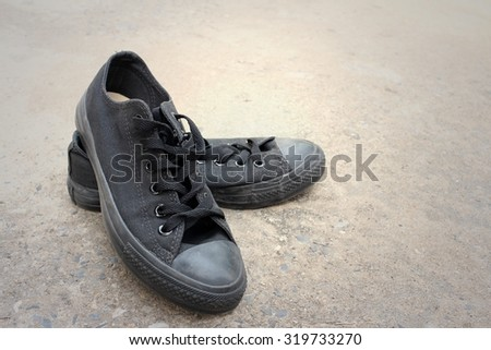 Black shoes on a background of cement.