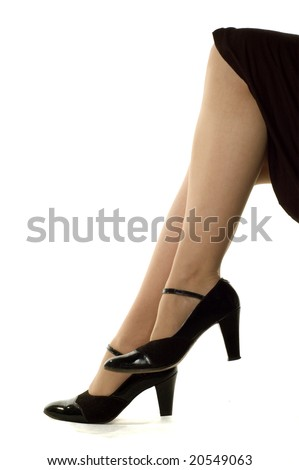 Black shoes on nice female legs, isolated