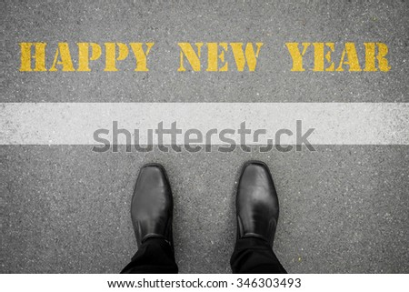 Black shoes standing in front of new year 2016 line