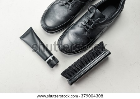 Black Shoes with Polishing Brush - stock photo