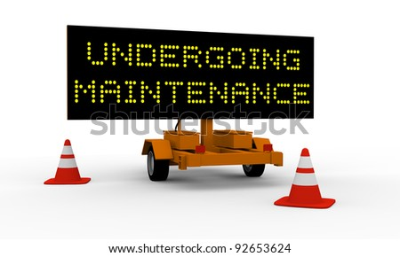 Black signboard on the top of a roadworks cart saying Undergoing maintenance