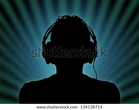 black silhouette of a dj in headphones in the night club - stock photo