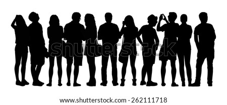 black silhouette of a large group of young people standing outdoor in different postures, watching, taking photos, back view - stock photo