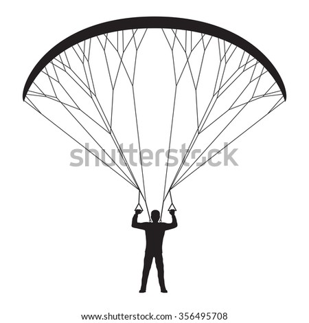 Black silhouette of a man with a paraglider. Paraglider. Paraplane. Kite.  - stock photo