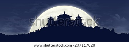 black silhouette of a traditional Tibetan Buddhist monastery on the hill covered with vegetation at full moon, large panoramic view - stock photo