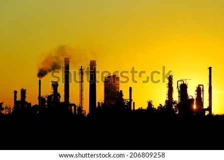 black silhouette of big crude oil refinery from Russia  - stock photo