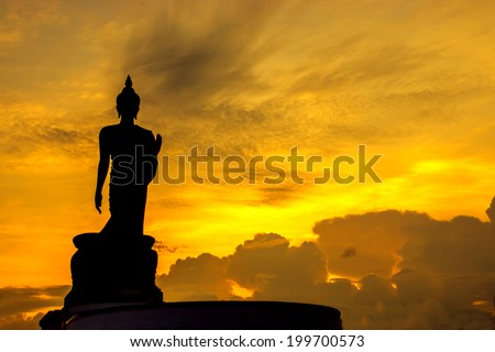 Black silhouette of Buddha statue, Thailand.