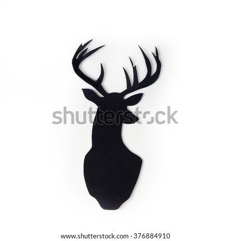 Black silhouette of deer at white background - stock photo