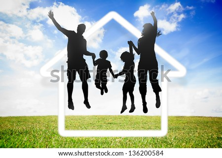 Black silhouette of family jumping in the air - stock photo