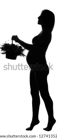 Black silhouette of pregnant woman with basket of flowers on white background