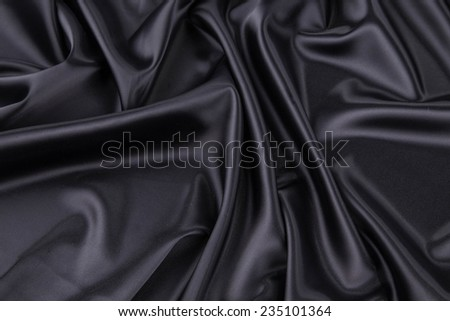 Black silk drapery. Isolated as a whole background.  - stock photo