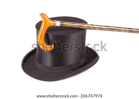 Black silk hat and walking stick on a white background - stock photo