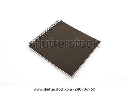 Black Sketch book on white background. - stock photo