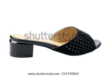 Black slipper isolated on white background. - stock photo