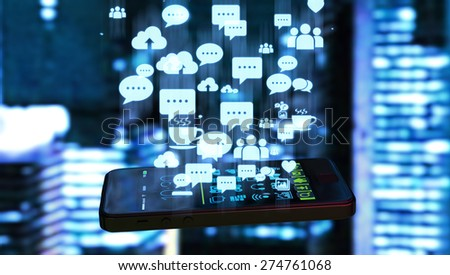 Black smart phone emitting holographic image of social media related icons and blurred night city background. - stock photo