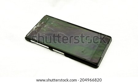 Black smart phone with broken, cracked and shattered glass liquid crystal display touch screen isolated on white - stock photo