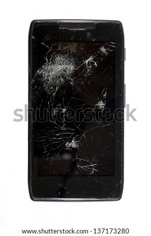 Black smartphone with a shattered screen isolated on white.
