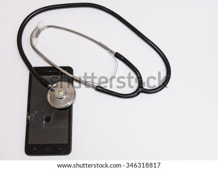Black smartphone with broken glass and stethoscope. Concept of care needs, to repair. In abstract broken, you can not go back.