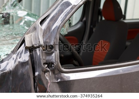 Black smashed family car after a serious accident - stock photo