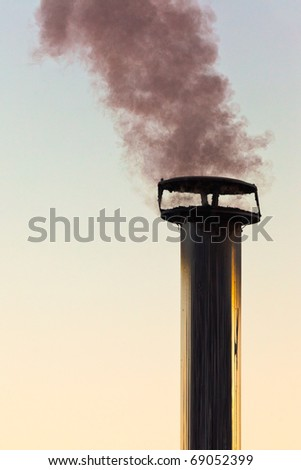 Black smoke emission from chimney polluting the environment. - stock photo