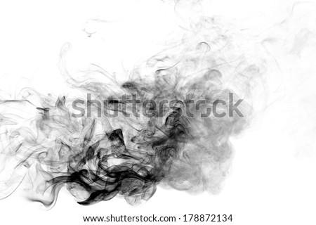 Black smoke on a white background. - stock photo