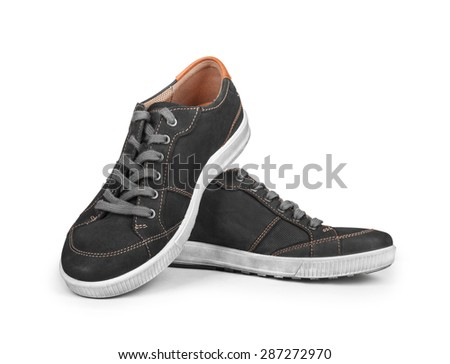 black sneakers isolated on white background - stock photo