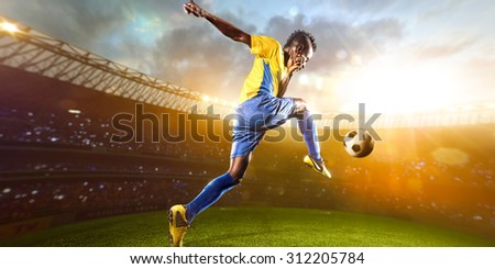 Black soccer player in action. Stadium field  Panorama view - stock photo